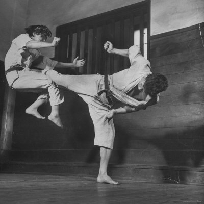 Law Student Gojuro Harada Uses Right Foot on the stomach to ward off attack of economics student Photographic Print by John Florea