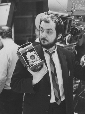 "Film Director Stanley Kubrick Holding Polaroid Camera During Filming of ""2001: A Space Odyssey"" Premium Photographic Print by Dmitri Kessel"