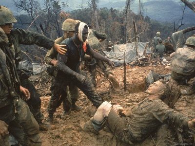 Wounded Marine Gunnery Sgt. Jeremiah Purdie During the Vietnam War Photographic Print by Larry Burrows