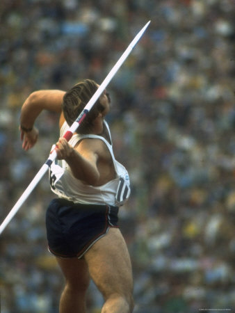 US Track Athlete William Schmidt Throwing Javelin at the Summer Olympics Premium Photographic Print by John Dominis