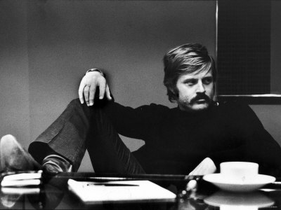 Actor Robert Redford Brooding While Conferring with His Agent Premium Photographic Print by John Dominis