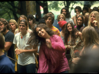 Psylvia Dressed in Pink Indian Shirt, Dancing in Midst of Crowd During Woodstock Music/Art Festival Photographic Print by Bill Eppridge