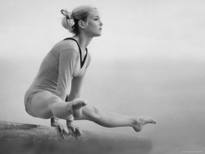 Gymnast Cathy Rigby, Training on Balancing Beam Premium Photographic Print by John Dominis