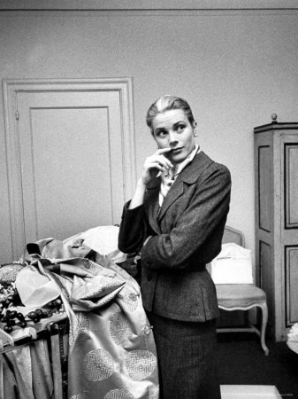 Actress Grace Kelly Packing Clothing Prior to Her Wedding to Prince Rainier Metal Print by Lisa Larsen