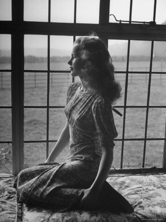Actress Peggy Cummins Looking Out of a Window Premium Photographic Print by Bob Landry