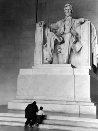 Black Man and Small Boy Kneeling Prayerfully on Steps on Front of Statue in the Lincoln Memorial Photographic Print by Thomas D. Mcavoy