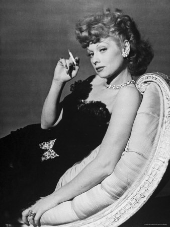 Dancer/Actress Lucille Ball in Strapless Black Lace Evening Dress, Holding Lit Cigarette on Couch Premium Photographic Print by John Florea