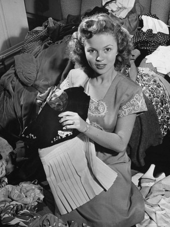 Actress Shirley Temple, Gathering Her Unwanted Clothes Together to Donate to a Clothing Drive Metal Print by Martha Holmes