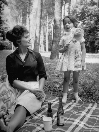 """Actress Sophia Loren with Girl Holding a Flower During Picnic While Filming """"Madame Sans Gene"""" Metal Print by Alfred Eisenstaedt"""