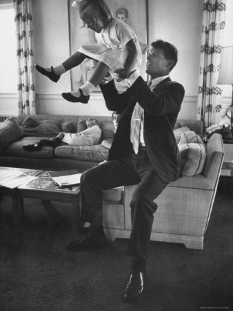 Robert F. Kennedy Playfully Tossing His Daughter Mary Kerry Kennedy Into the Air Metal Print by John Dominis