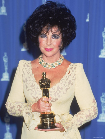 http://cache2.allpostersimages.com/p/LRG/27/2777/QXUTD00Z/posters/elizabeth-taylor-holding-her-oscar-in-press-room-at-academy-awards.jpg