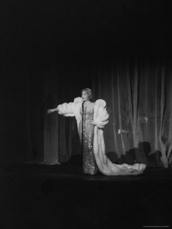 Marlene Dietrich, Wearing White Ermine Fur Coat During Her First Performance at the Titania Palast Metal Print by James Whitmore