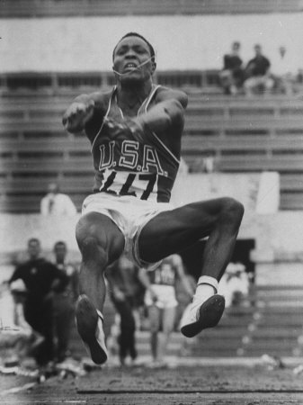 Rafer Johnson in Decathlon Broad Jump in Olympics Metal Print by James Whitmore