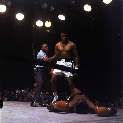 Heavyweight Boxer Cassius Clay, aka Muhammad Ali, Standing over Opponent Sonny Liston Premium Photographic Print by George Silk