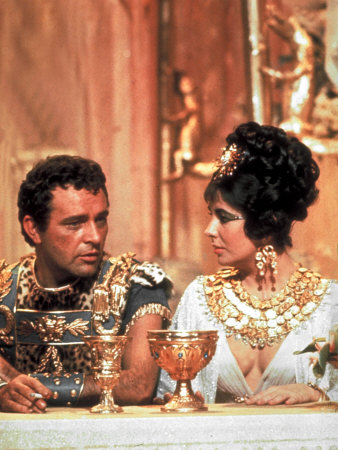 Richard Burton and Elizabeth Taylor, in Costume, Chatting on Set During Filming of Cleopatra Metal Print by Paul Schutzer