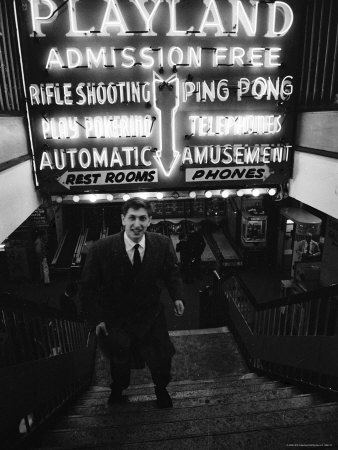 Chess Champion Bobby Fischer at the Entrance to a Playland Arcade Metal Print by Carl Mydans