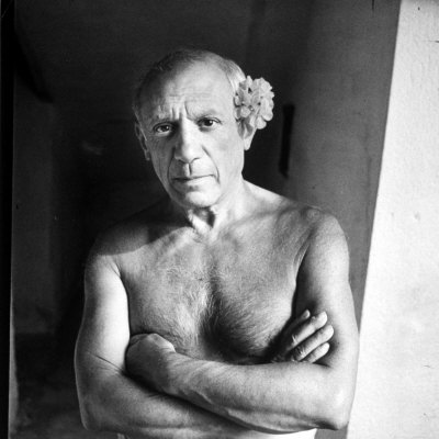 Pablo Picasso, Bare Chested and with Flower Tucked Behind Ear Premium Photographic Print by Gjon Mili