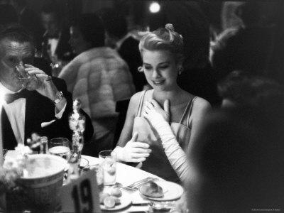 Grace Kelly Sitting at Romanoff's Premium Photographic Print by George Silk