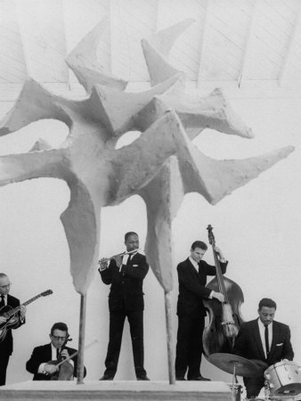 """Jazz Drummer Chico Hamilton Playing with Band Behind Sculpture Called """"Counterpoints"""" Metal Print by Gordon Parks"""