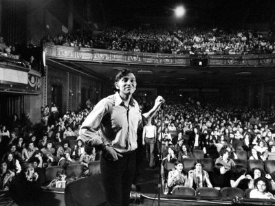 Rock Promoter Bill Graham Onstage with Audience Visible, at Fillmore East Metal Print by John Olson