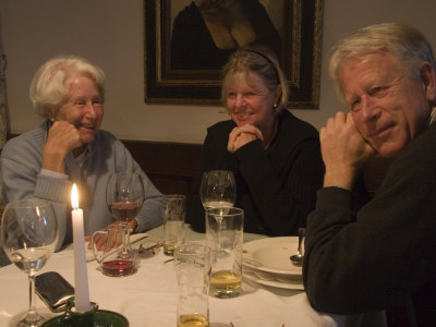 A Family Sits Around the Dinner Table at a Restaurant, Fraueninsel, Chiemsee, Bavaria, Germany Photographic Print by Taylor S. Kennedy