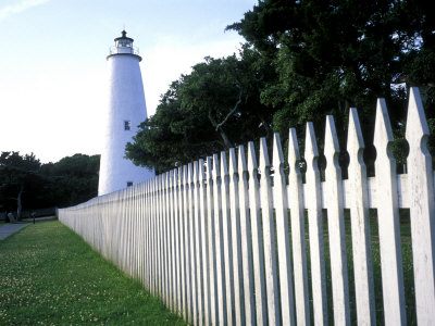 The Lighthouse Stands Behind a Fence on Ocracoke Island Photographic Print by Stephen Alvarez