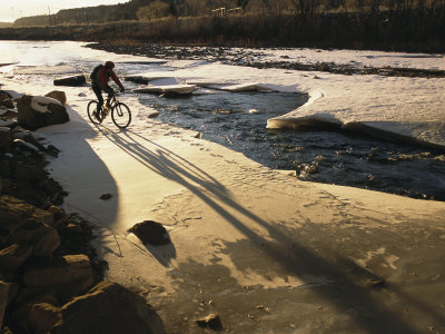 Winter Bicycling on the Partially Frozen Dolores River Photographic Print by Kate Thompson