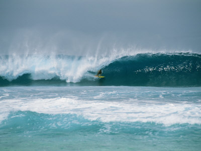 Surfer in the Crest of a Wave in the Bonsai Pipeline in Oahu Photographic Print by Todd Gipstein
