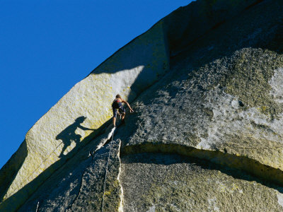 A Rock Climber Scales the Flat Rock Surface of a Cliff Near Needles, California Photographic Print by Barry Tessman