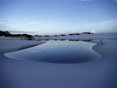 A White Sand Dune with a Pool of Water Reflecting the Sky Photographic Print by Sam Abell