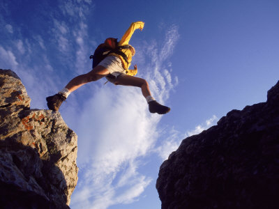 Backpacker Jumping to Rocks, Park City, UT Photographic Print by Cheyenne Rouse