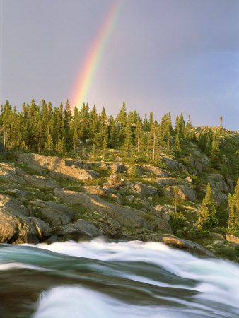 The Mist-Filled Tides of Clearwater River Wash against a Rocky Shore Where a Ra Inbow Takes Form Photographic Print by Barry Tessman