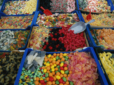 Inviting Arrays of Multi-Colored Candies in the Plaza De Catalonia Photographic Print by Stephen St. John