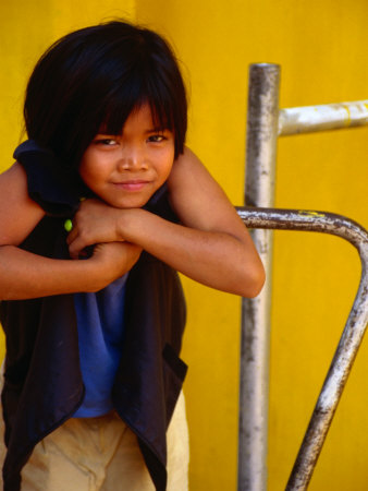 Portrait of Lao Girl at Entrance to Wat St. Muang, Vientiane, Vientiane Prefecture, Laos Photographic Print by Martin Lladó