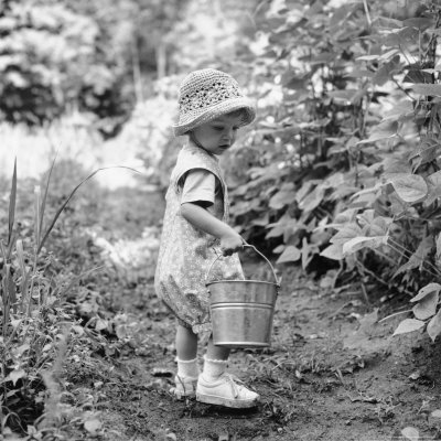 Little Girl with Hat and Pail Outdoors Photographic Print