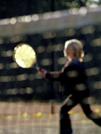Blurry Image of a Girl Playing Tennis Photographic Print