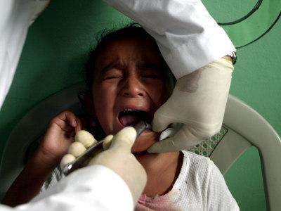 A Girl, 6, Cries as Dentist Allan Castellanos Removes a Molar Toot Photographic Print