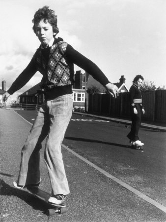 Boy Balances on His Skateboard with a Look of Concentration on His Face Photographic Print by Gill Emberton