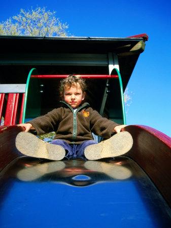 Boy on Slide, Copenhagen, Denmark Photographic Print by Martin Lladó