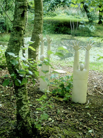 Contemporary Sculpture, Figures Rising from Ground in Woodland Photographic Print