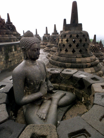 A Statue of Buddha Sits on a Terrace Photographic Print by Dita Alangkara