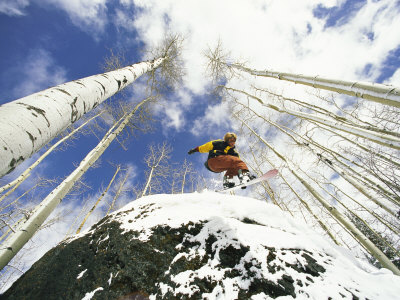 Snowboarder Jumps off a Rock in Telluride, Telluride, Colorado Photographic Print by Paul Chesley