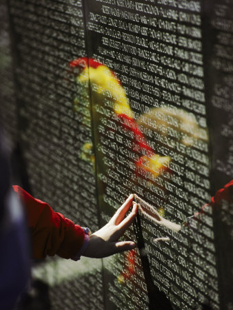 A Hand Reaches out to Touch a Name on the Vietnam Wall Photographic Print by Steve Raymer