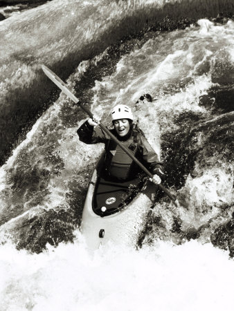 A Kayaker Careens over a Waterfall into the Swirling White Water Below Photographic Print by Barry Tessman