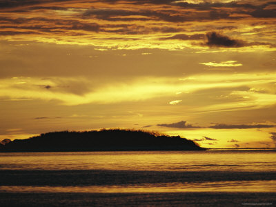 Golden Sunset over a Small Island Photographic Print by Wolcott Henry