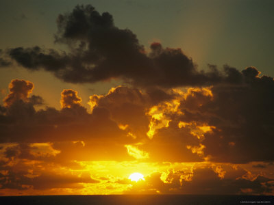 Sunset Through Dramatic Clouds over the Vast Pacific Ocean Photographic Print by Todd Gipstein