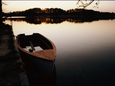 A Half-Sunken Rowboat Along an Inlet of the Chesapeake Bay Photographic Print