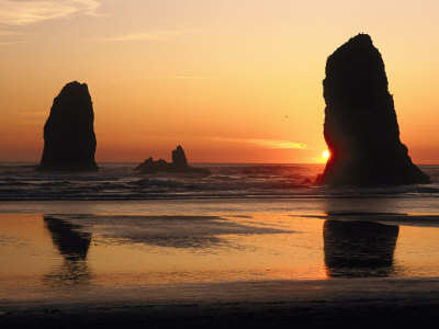 The Sun Sets over the Sea Stacks at Cannon Beach Photographic Print by Phil Schermeister