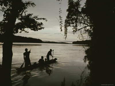 A Family in a Pirogue Canoe Travels up the Sangha River Photographic Print by Michael Nichols