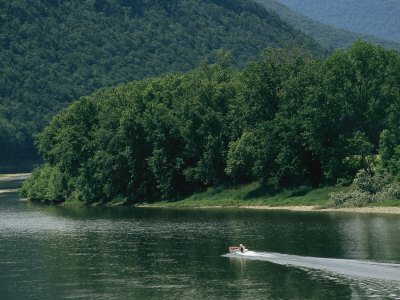 A Small Motorboat on the Susquehanna River Near the Endless Mountains Photographic Print by Raymond Gehman
